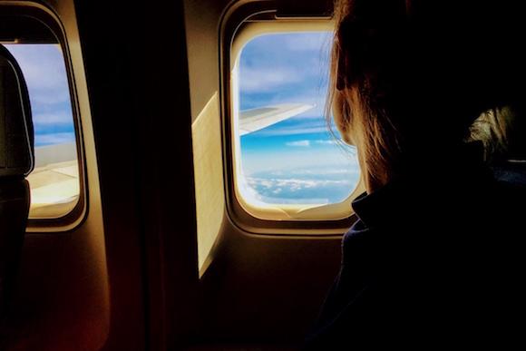 girl-window-plane-scared